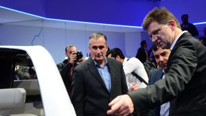 MobilEye and Intel executives examine BMW concept vehicle at CES 2017.